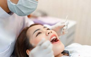asian woman receiving teeth whitening services at meyerland plaza tx near houston